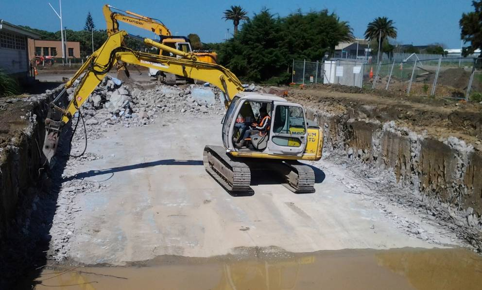 An excavator performing earth moving on a construction site