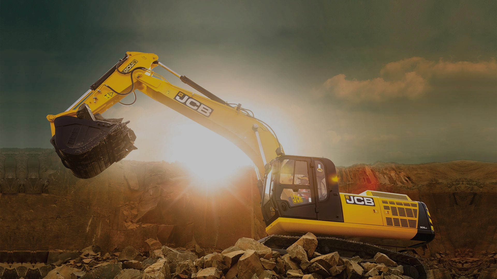 An excavator performing earthworks with the sun peaking out over the horizon